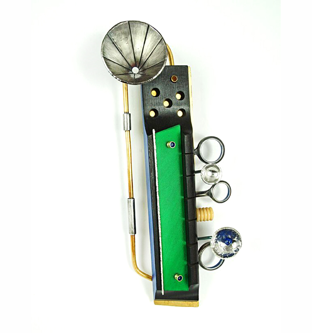 Vibe Brooch, 2015, Brass, sterling silver,nickle silver, vintage guitar and clarinet parts, bone, vinyl, lapis lazuli, paint, 5.75 x 2.75 x 1""