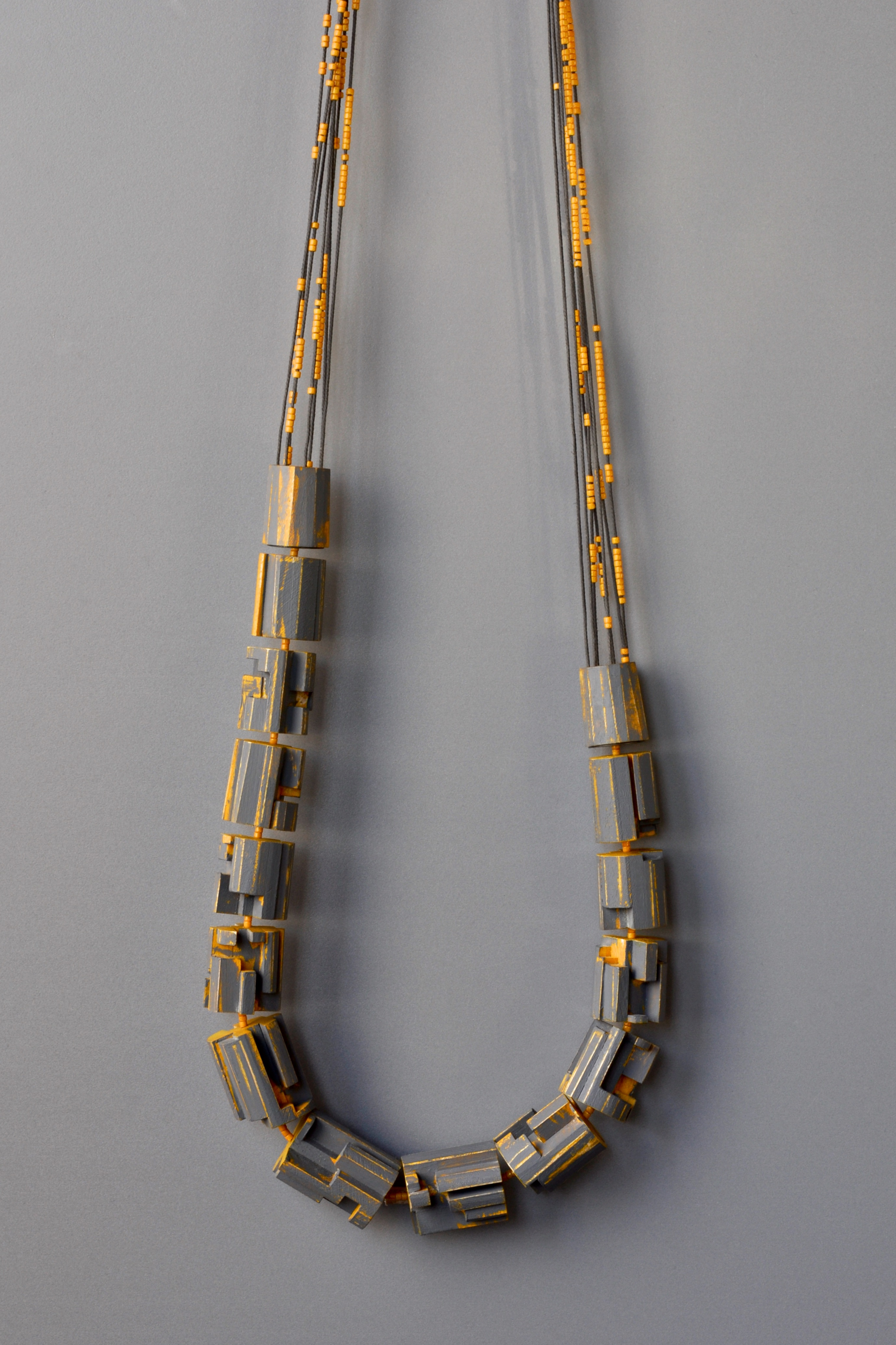 Julia Turner, Scape Necklace (Yellow/Grey), Maple, stain, paint, cord, Japanese glass beads