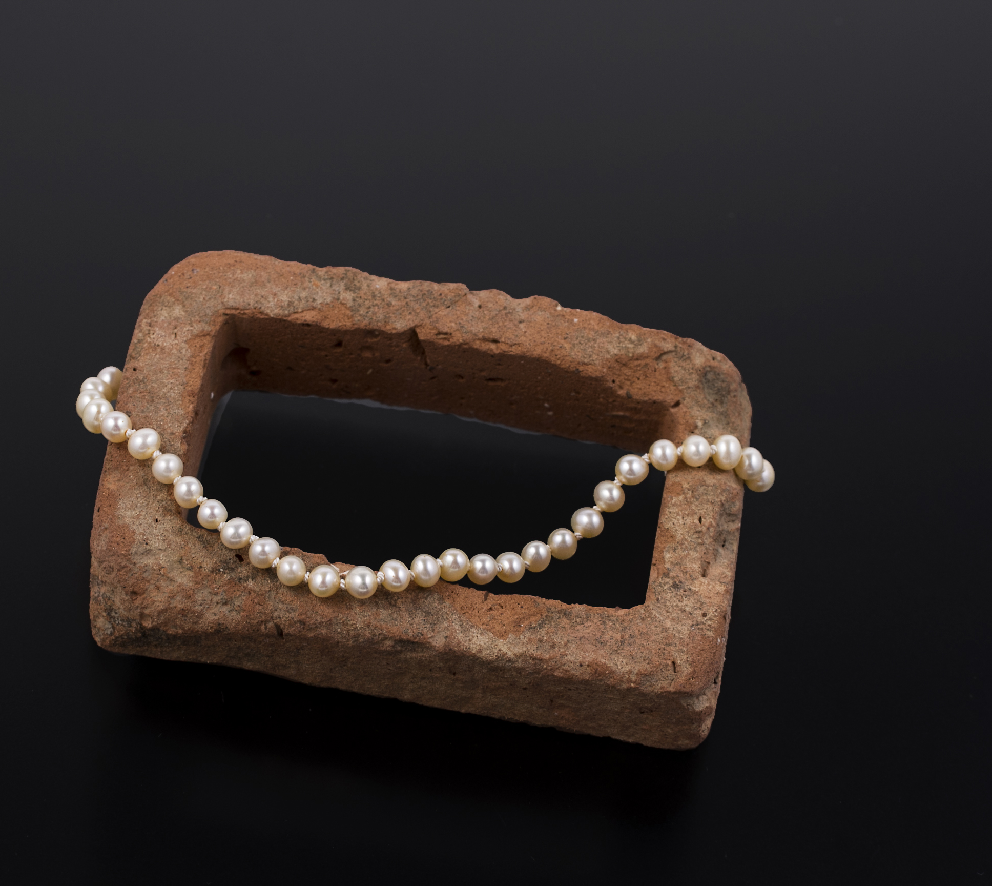 Transmutations 18, 2016, foraged brick, inherited pearls, silk, sterling silver