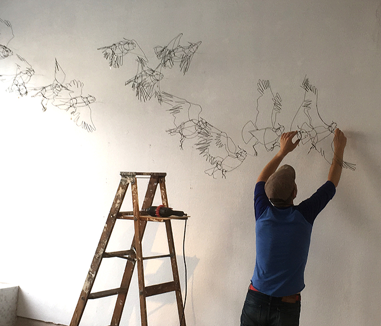 Tom Hill installing Bird Sequence
