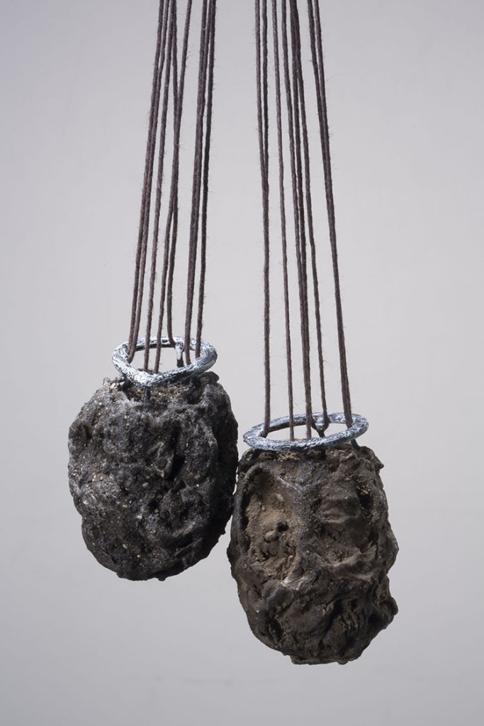 Lorena Lazard, Mexico, Tierra I and II, (pendants), 2013, Iron, polymer mud, string, earth from Tijuana, Mexcio, earth from San Ysidro, USA
