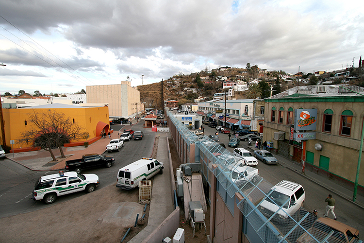 """U.S.-Mexico border at Nogales"" Photo by Sgt. 1st Class Gordon Hyde."