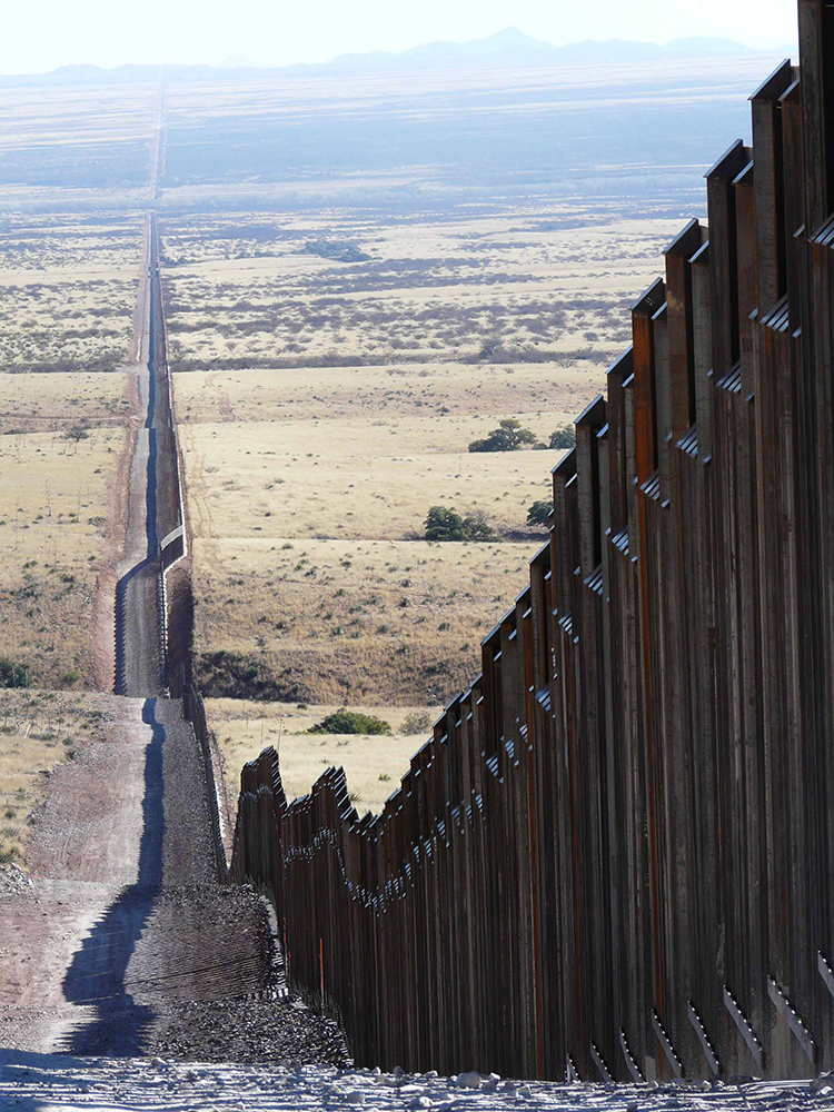 The metal border fence along the U.S.-Mexico border near the National Park Service's Coronado National Memorial, Arizona. Photo by Matt Clark.